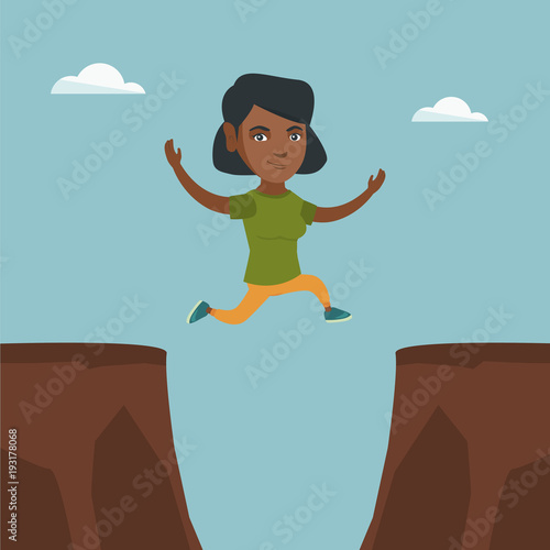 Young african-american sportswoman jumping over rocks with a