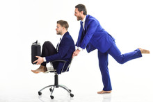 Man In Suit Pushing Chair With...