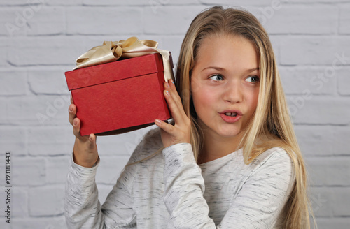 Christmas Gifts For 18 Year Old Female.Portrait Of Happy Smiling 10 Years Old Child Girl Holding A