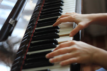 Hands Of Teenagers Plays On Piano - Musicial Concept