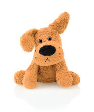 Cute Dog Doll Isolated On White Background With Shadow Reflection. Playful Bright Brown Dog Sitting On White Underlay.