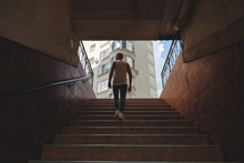 Young Man Climbing Stairs In P...
