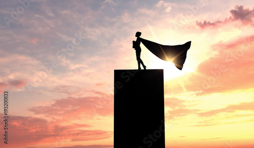Photo  Silhouette of a superhero business woman wearing a cape against a bright sky