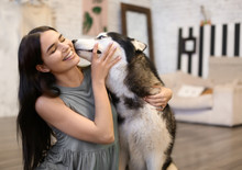 Young Woman With Cute Husky Do...