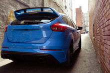 Blue Sports Car In An Alley