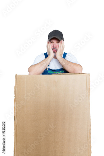 Fotografie, Obraz  Tired delivery man leaning against large package