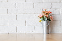 White Wall And Decorative Flower Wooden Table