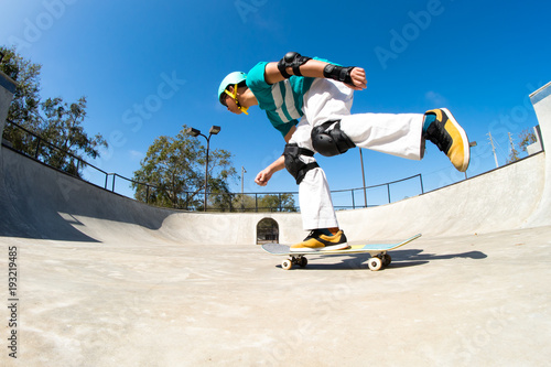 Fotografie, Obraz  Young skateboarder at a skatepark