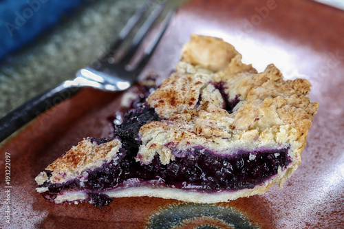 Fotografie, Obraz  Close up of a slice of blueberry pie with fork