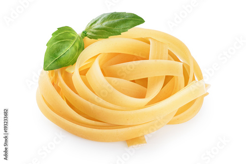 Fotomural  Raw tagliatelle pasta and basil isolated on white background.