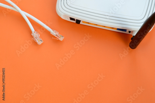 Internet router and Internet cable plugs lie on a bright orange background. Items required for Internet connection