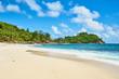 beautiful paradise beach anse bazarca. white sand,turquoise water,palm trees, granite rocks, seychelles