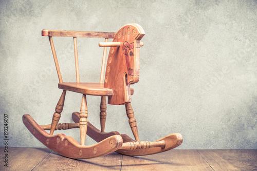 Valokuva Retro old wooden rocking horse front concrete wall background