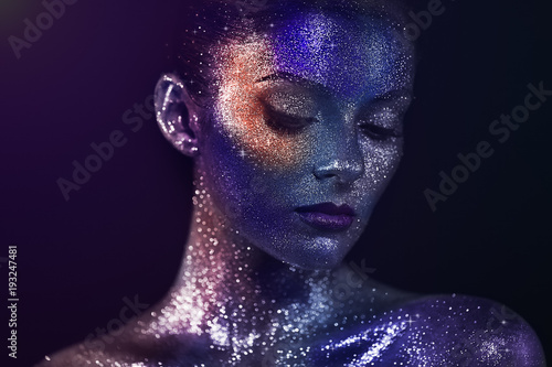 Fototapety, obrazy: Portrait of Beautiful Woman with Sparkles on her Face. Girl with Art Make-Up in Color Light. Fashion Model with Colorful Makeup