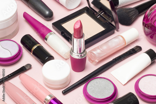 Set of makeup cosmetics, brushes, concealer and other essentials on pink backgro Canvas Print