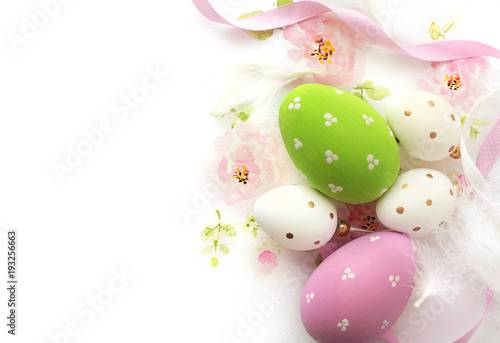 easter eggs and watercolor flowers on white background
