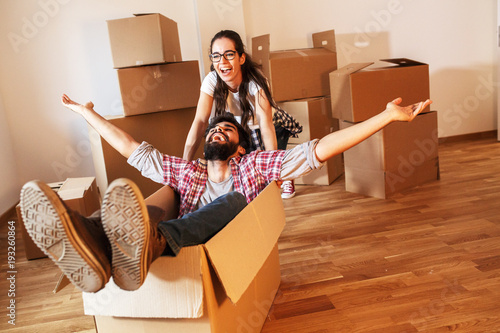 Fototapeta  Young couple moving into a new home