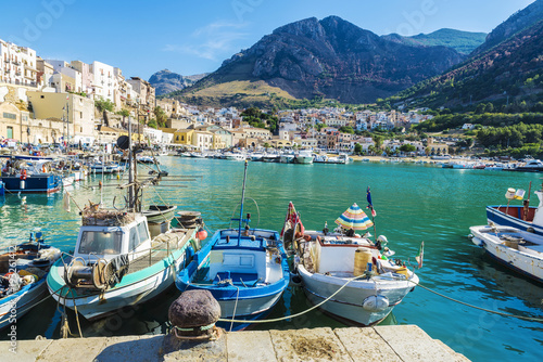 Fishing port with old wooden fishing boats in Sicily, Italy