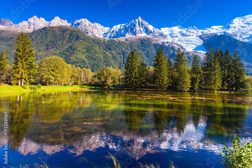 Poster de jardin Reflexion The lake reflected snow-capped Alps