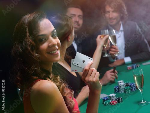 Poster  adult group celebrating friend winning blackjack