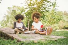 Little Afro Child Girl Reading...