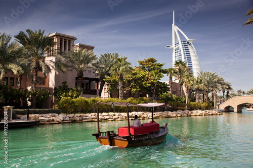 DUBAI, UAE - FEBRUARY, 2018: View on Burj Al Arab, the world only seven stars hotel seen from Madinat Jumeirah, a luxury resort which include hotels and souk spreding across over 40 hectars.