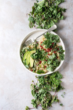 Vegan Quinoa Salad With Kale, Young Beetroot Leaves, Garnet Seeds, Sliced Avocado In White Plate With Ingredients Above Over Grey Texture Background. Top View, Space. Healthy Eating