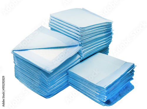 piles of toilet pads for pets isolated on white Canvas Print