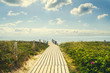 Wooden bridge to the sea. The sky with beautiful clouds. Recreation.Travel.