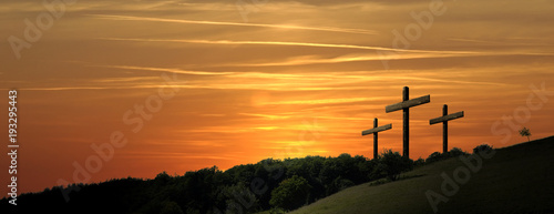 Foto Religious representation with three crosses and nature landscape background