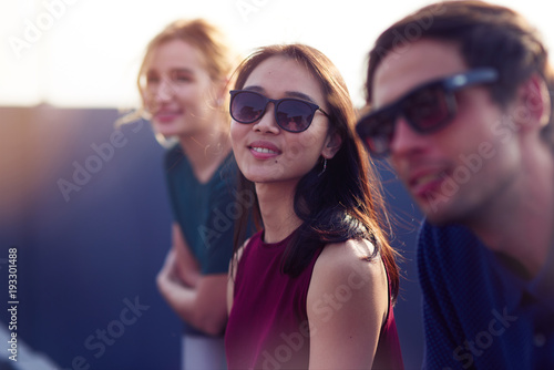 Attractive thai woman resting with her friends