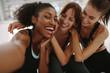 canvas print picture - Friends talking self portrait in fitness studio