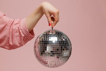 Mirror Disco Ball Girl Holding Her Hand On Pink Background. Concept Party, Holiday. Copy Space