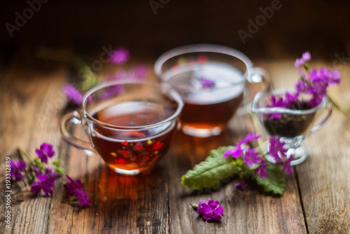 Photo Stands Roe glass of tea brewed with therapeutic Linden