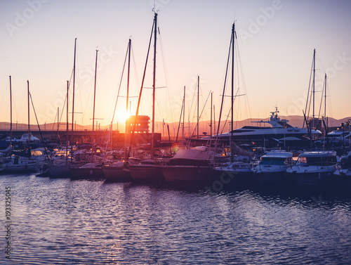 Photo dock with white boats and yachts on a beautiful colorful sunset on the Cote d'Az