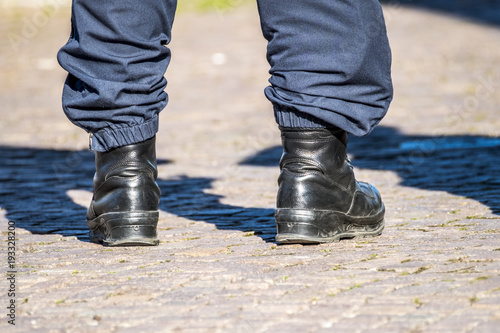 Fotografia, Obraz Military style black boots in the streets
