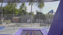 Professional Gymnast Jumping On The Trampoline And Doing Tricks In Slow Motion