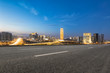 empty asphalt road and modern buildings in Zhengzhou east new district at night