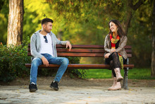 Young Couple In Park Flirting