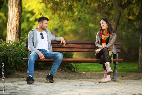 Young couple in park flirting Wallpaper Mural