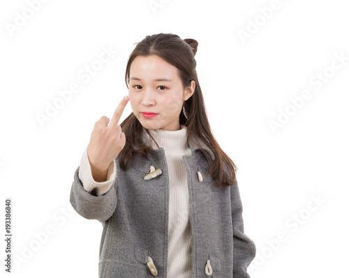 Serious and angry young woman showing middle finger, showing her anger Wallpaper Mural
