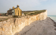 Coastal Erosion, Sussex, UK. A Diminishing Row Of Terraced Houses Displaying The Effects Of Weather On The Chalk Cliffs Of The South Of England.