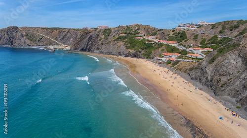 Foto auf Gartenposter Blau Jeans Aerial. Tourists surfers on the beach of Arrifana.