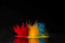 Red, Blue And Yellow Holi Powd...