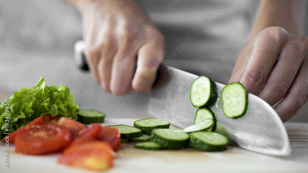 Fototapety, obrazy: Housewife hands cutting cucumber on kitchen board, vegetable salad cooking steps