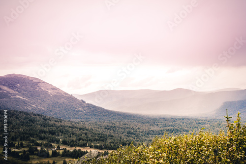 Keuken foto achterwand Heuvel Mountain country under the pastel pink sky. A romantic trip to the mountains. The beauty of nature, dawn over the hills.
