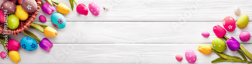 Stampa su Tela Easter Eggs with Flowers on White Wooden Background