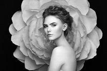 Beautiful Woman On The Background Of A Large Flower. Beauty Summer Model Girl With Peony. Young Woman With Elegant Hairstyle And Makeup. Fashion Photo