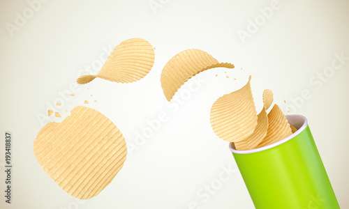 Fotografie, Obraz  Crispy Potato chips rolled out of the Green cylinder