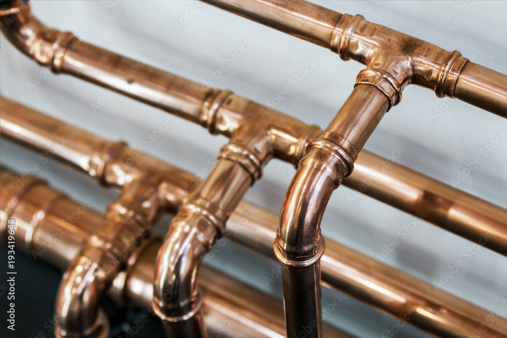 Fototapeta copper pipes and fittings for carrying out plumbing work.